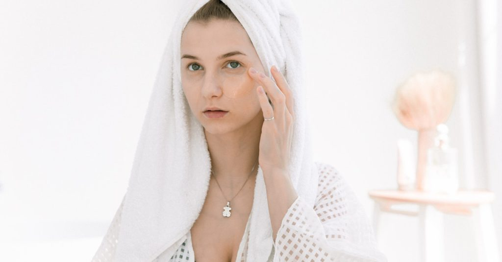 This image shows a woman applying CBD on dry skin.